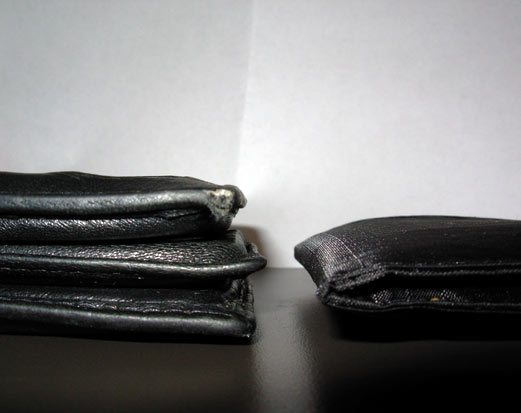 Empty old wallet versus new wallet all full
